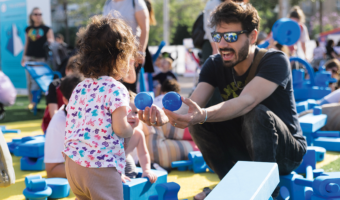 Father playing with child at pop-up play event in Tel Aviv