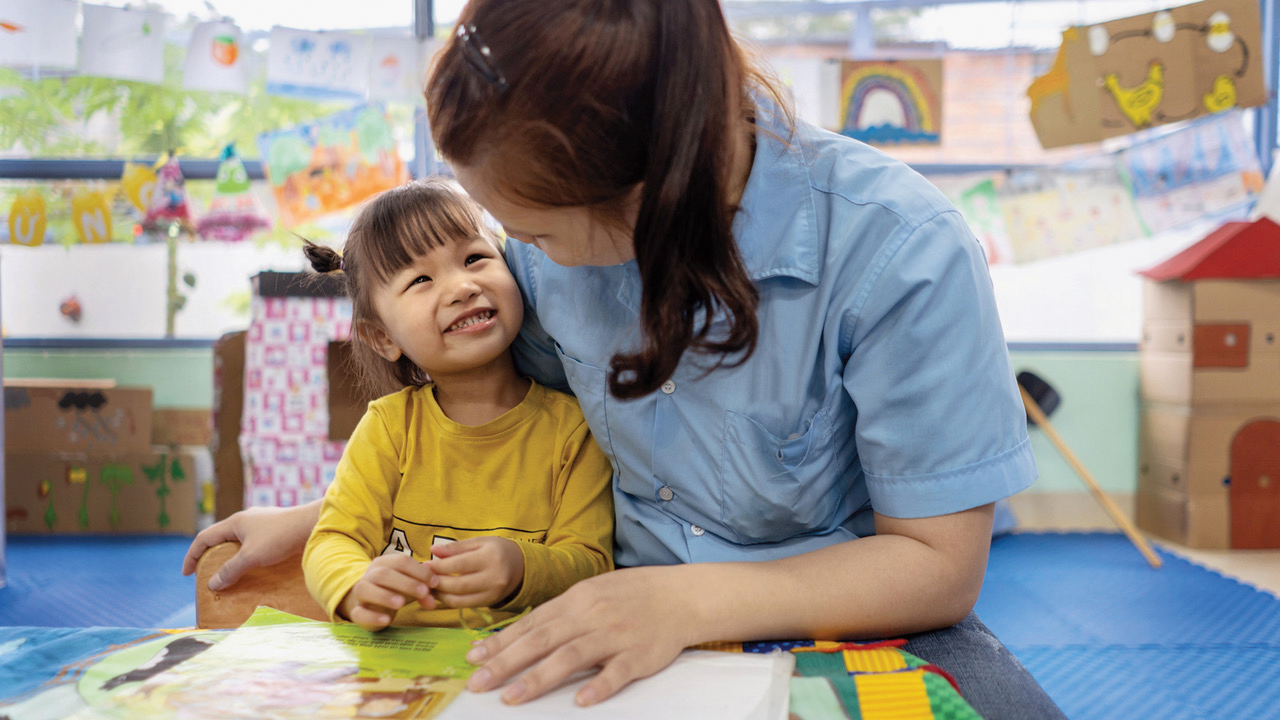 Teacher and child at OneSky Early Learning Centre in Vietnam