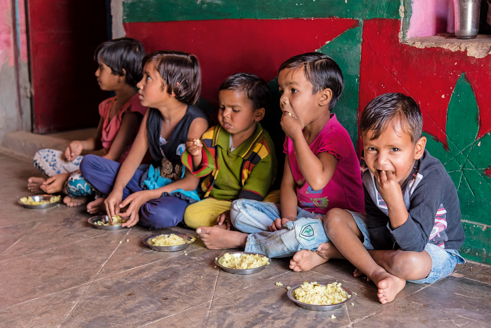 Young children eating fortified porridges